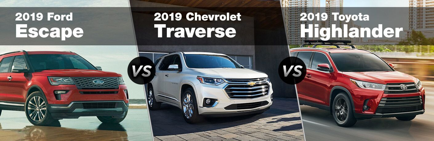 2019 Ford Explorer next to a 2019 Chevy Traverse and 2019 Toyota Highlander