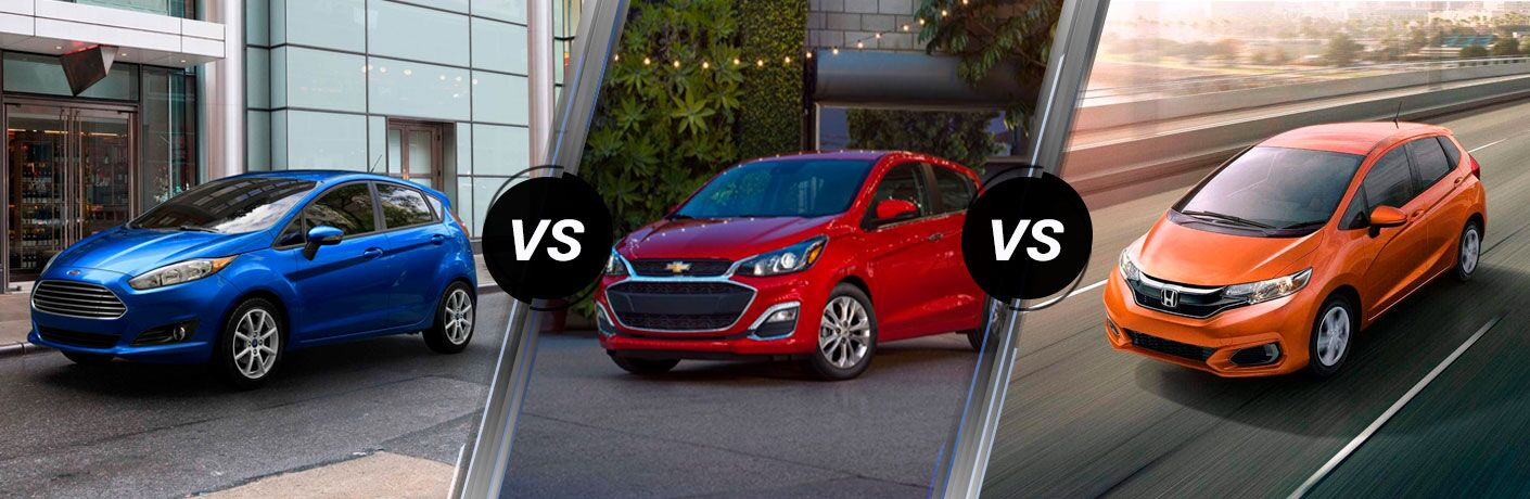 A 2019 Ford Fiesta next to a 2019 Chevy Spark and 2019 Honda Fit