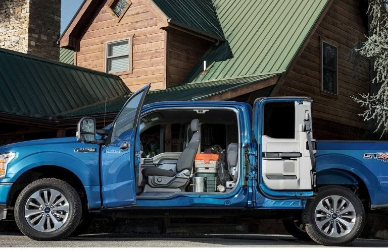 Exterior view of cargo room in cab of 2020 Ford F-150 in front of house