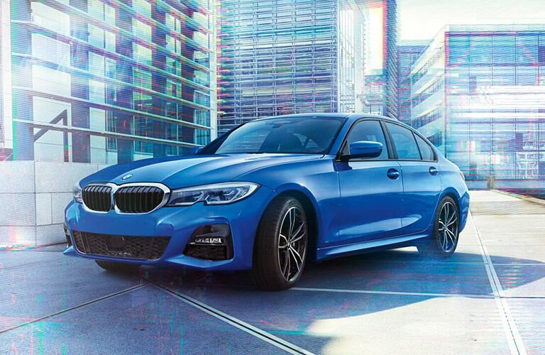 Front driver angle of a blue 2019 BMW 3 Series parked in a city