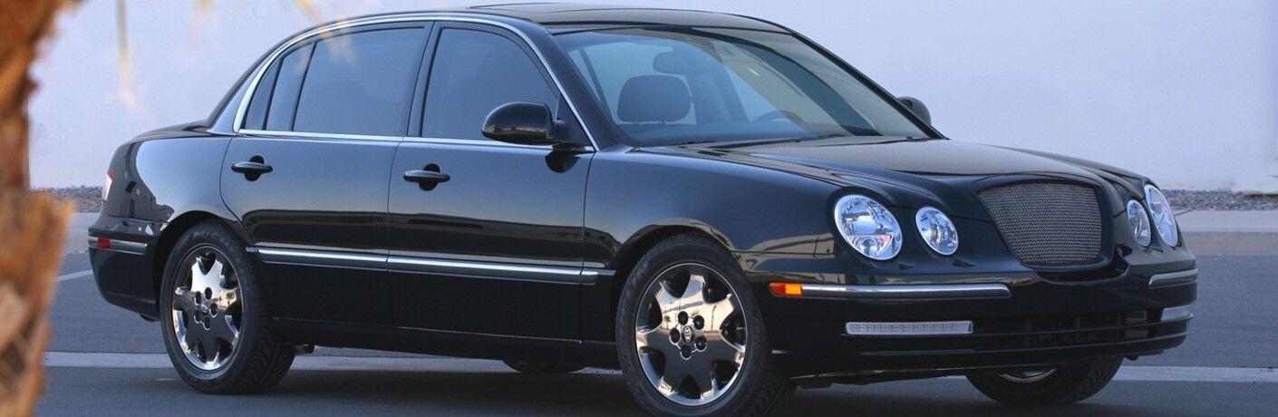 Front passenger angle of a black 2004 Kia Amanti
