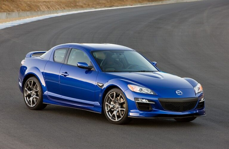 Front passenger angle of a blue 2009 Mazda RX-8
