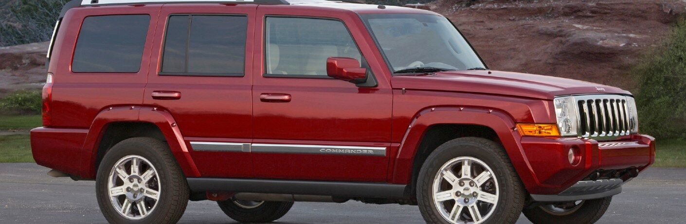 Front passenger angle of a red 2010 Jeep Commander