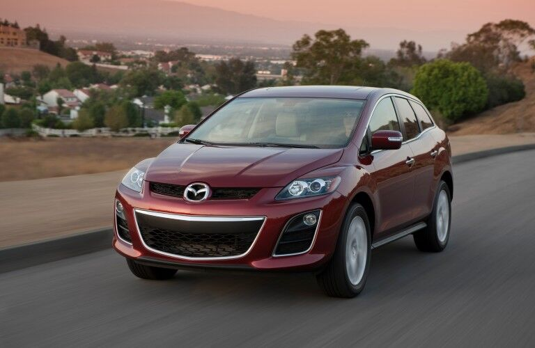 Front driver angle of a red 2012 Mazda CX-7