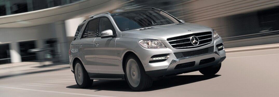Front passenger angle of a silver 2012 Mercedes-Benz M-Class driving on a road