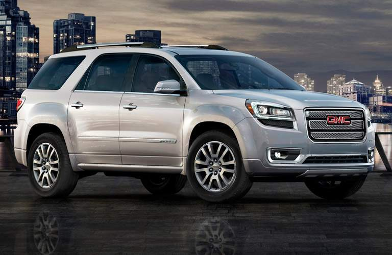 2014 GMC Acadia parked in front of a cityscape