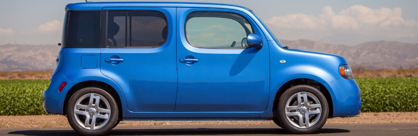 Passenger angle of a blue 2014 Nissan cube