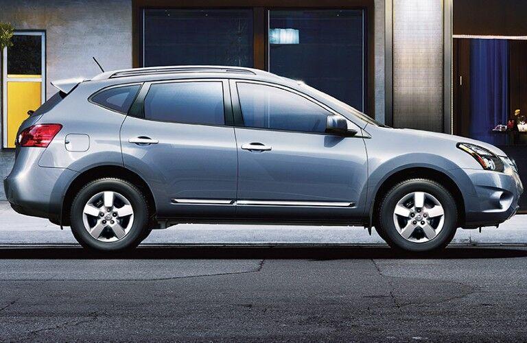 Passenger angle of a grey 2014 Nissan Rogue Select