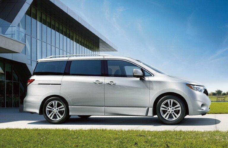 Passenger angle of a white 2015 Nissan Quest