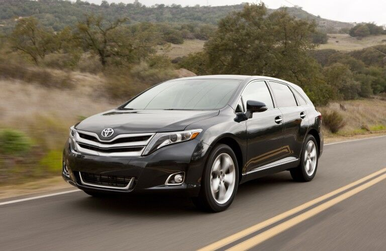 Front driver angle of a black 2015 Toyota Venza driving on a road