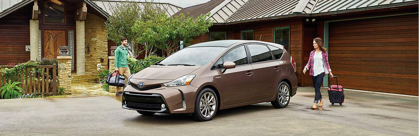 Two people approaching the 2015 Toyota Prius