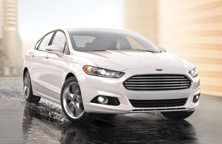 2016 Ford Fusion driving on a wet road
