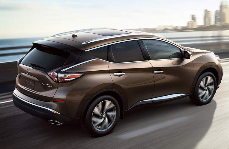 2016 Nissan Murano driving towards a city