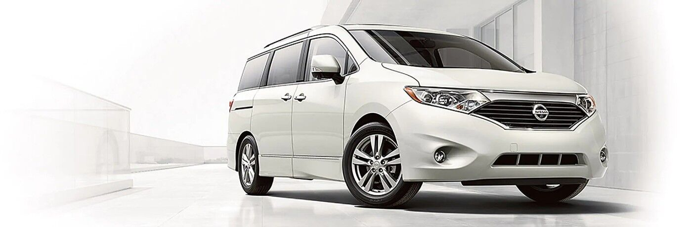 Front passenger angle of a white 2017 Nissan Quest