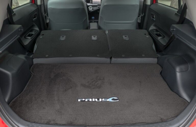 Cargo space inside the 2016 Toyota Prius c with the rear seats folded
