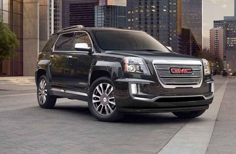 Front quarter profile of the 2017 GMC Terrain parked inn front of a tall building in a city