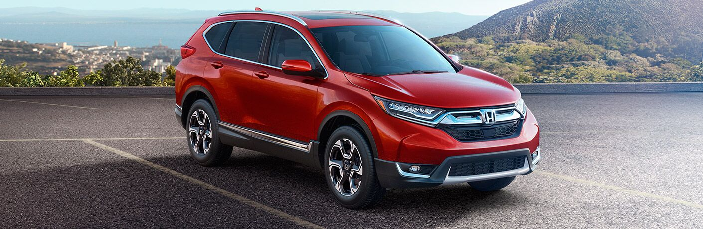 2017 Honda CR-V parked in a lot in front of a mountain over looking a valley