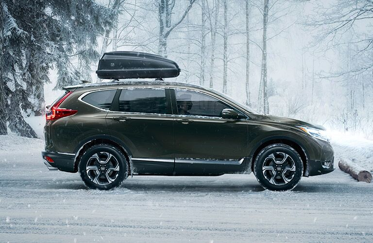 2017 Honda CR-V parked on a snowy parking lot near a woods