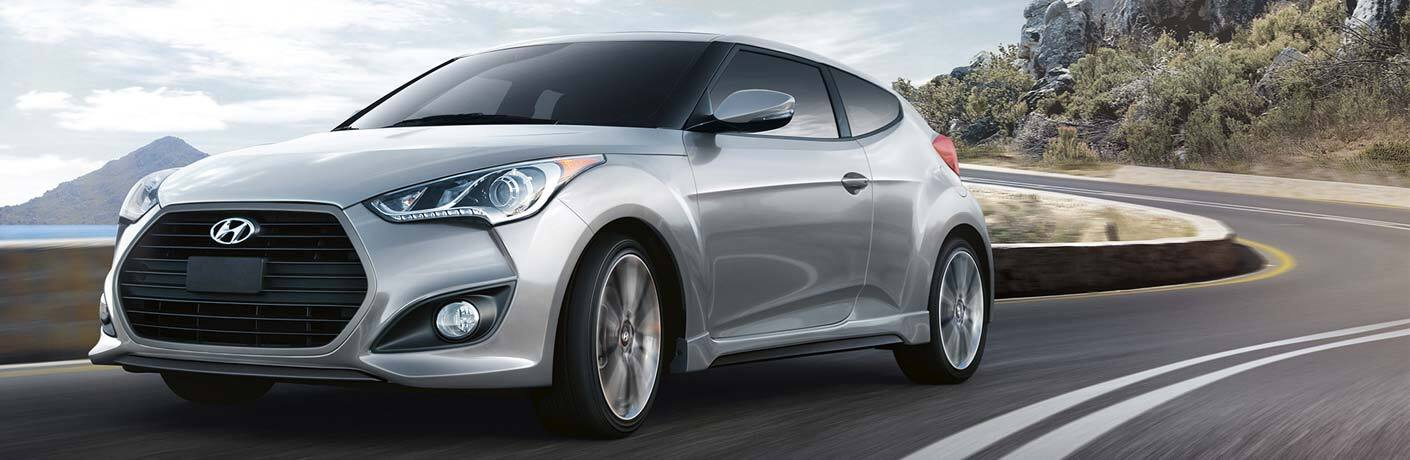 Hyundai Veloster driving on a road