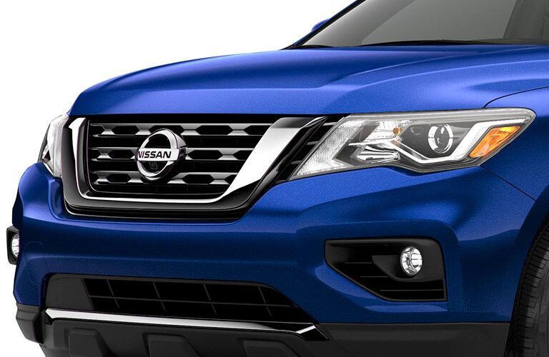 Front closeup of the nose, grille, headlight, and fog lights on the 2017 Nissan Pathfinder