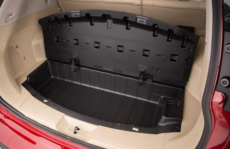 Interior cargo space of the 2017 Nissan Rogue with a storage option open