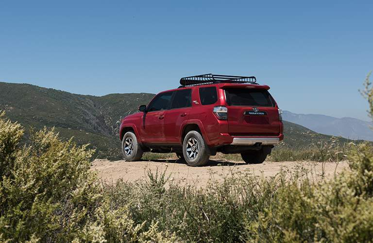 Rear image of the 2017 Toyota 4Runner on an overlook in front of a mountian