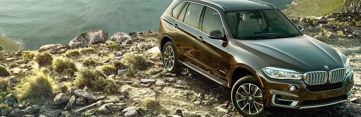 BMW X5 parked on some rocks