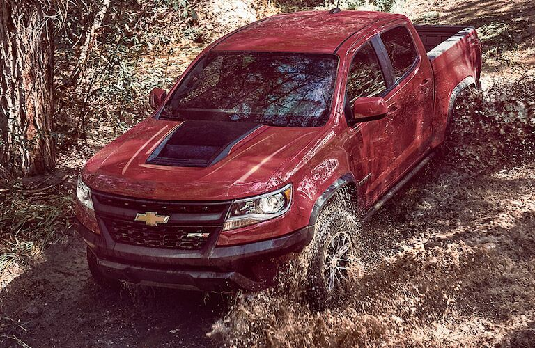 Chevy Colorado driving downhill on off-road trail