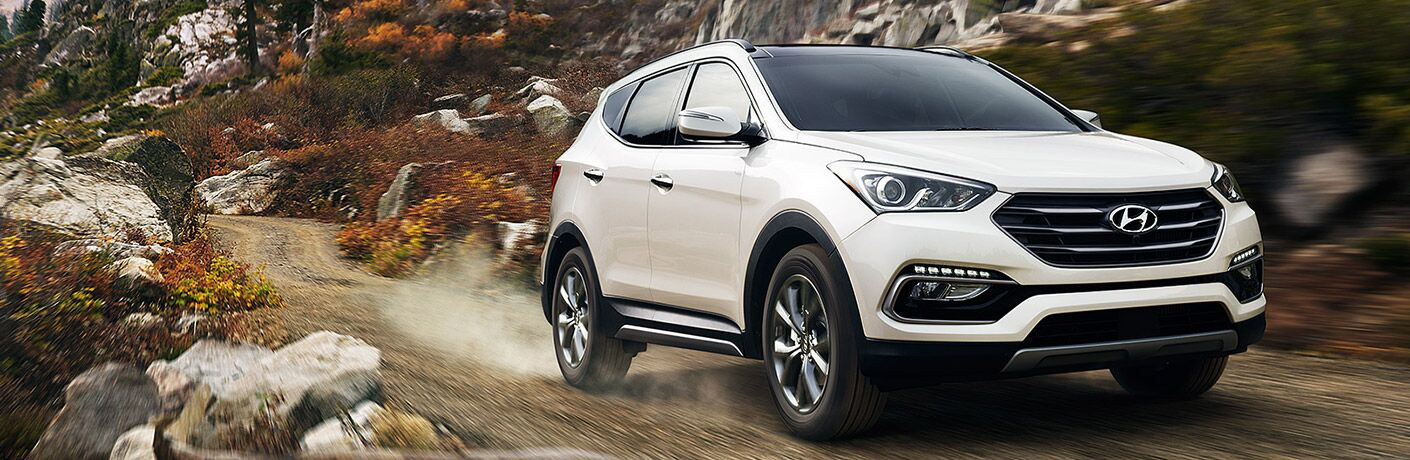 Hyundai Santa Fe driving on an off-road trail