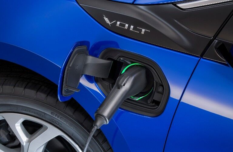 Close up of the charger plugged into a blue 2018 Chevy Volt