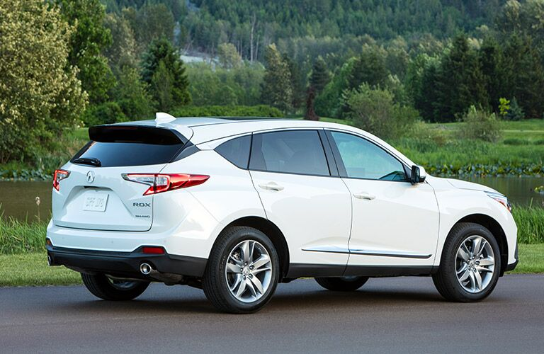 Rear passenger angle of a white 2019 Acura RDX parked outdoors