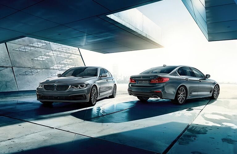 Front and rear angles of two 2019 BMW 5 Series vehicles