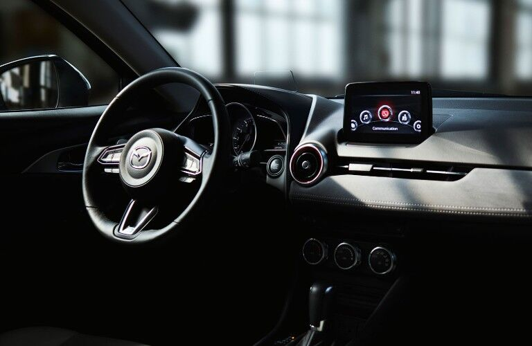 Steering wheel and touchscreen display inside the 2019 Mazda CX-3