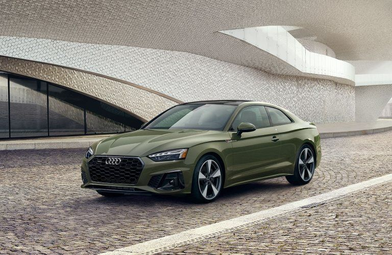 Front driver angle of a green 2020 Audi A5 Coupe