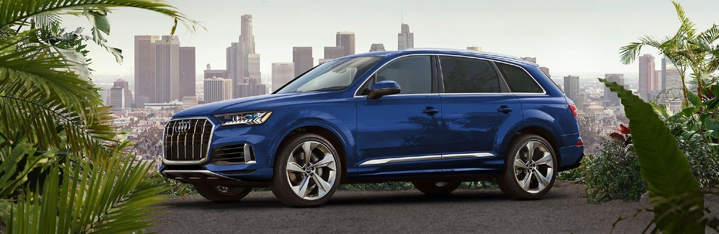 Front driver angle of a blue 2020 Audi Q7