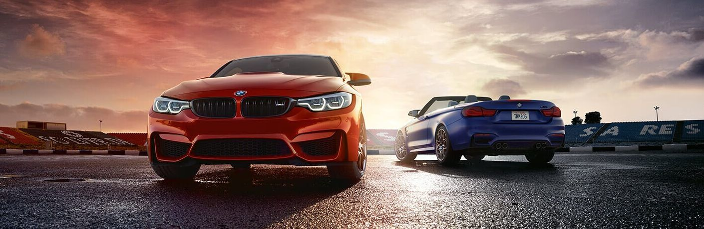 Front angle of a red 2020 BMW 4 Series and rear angle of a blue 2020 BMW 4 Series