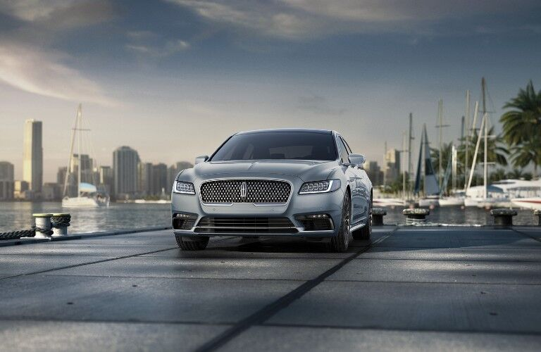Front driver angle of a silver 2020 Lincoln Continental parked on a pier