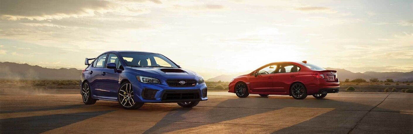 Blue 2020 Subaru WRX with a red 2020 Subaru WRX