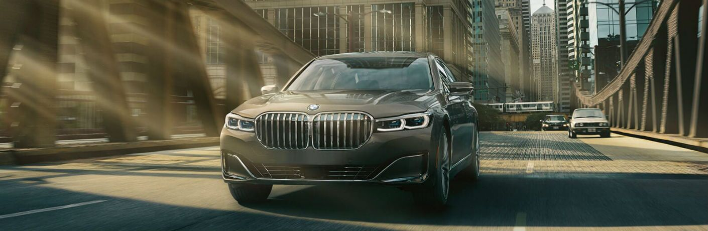 2020 BMW 7 Series front fascia driving on bridge