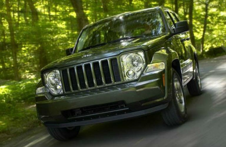 Jeep Liberty driving on a road