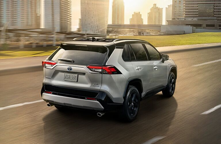 2019 Toyoyta RAV4 with the city in the background