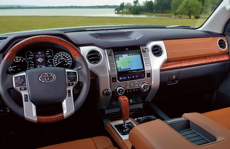 Interior front cabin of the 2019 Toyota Tundra, showcasing infotainment, steering wheel, and unique color palette.