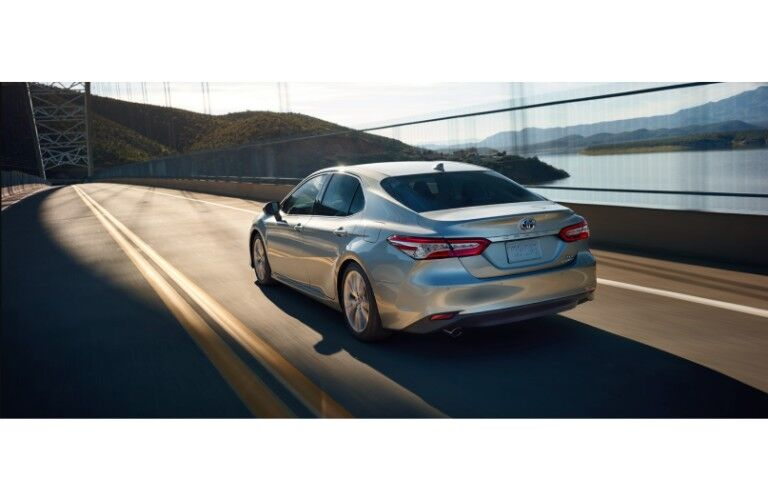 2019 Toyota Camry gray driving down highway