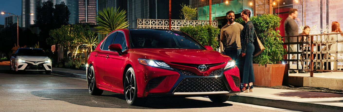 2019 Toyota Camry red outside diner at night with people nearby