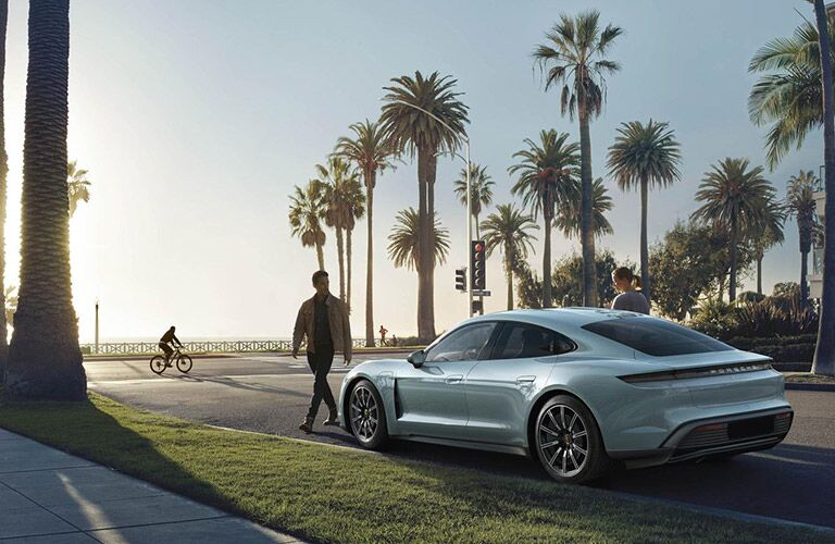 2020 Porsche Taycan with palm trees