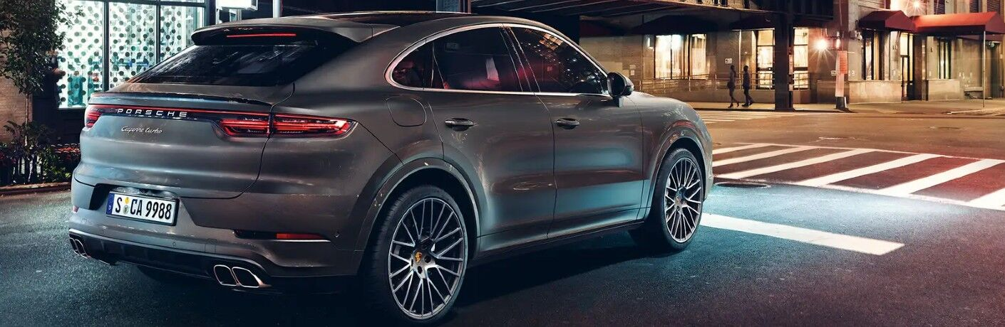 2021 Porsche Cayenne on city street at night