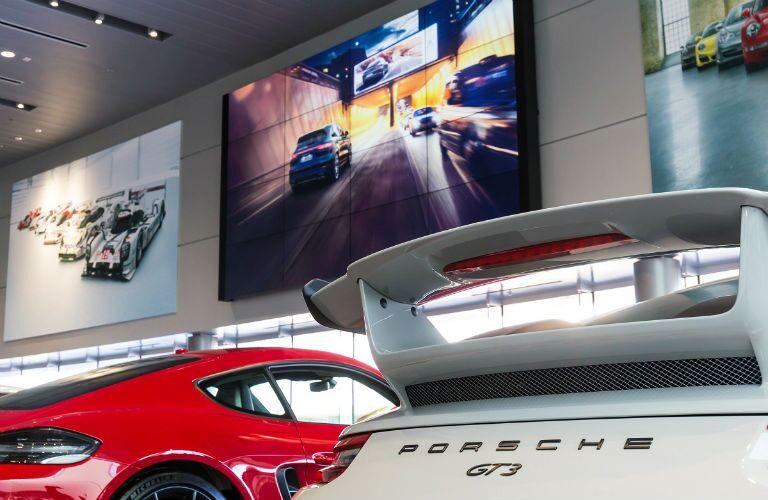 big screen at porsche of kansas city dealer experience