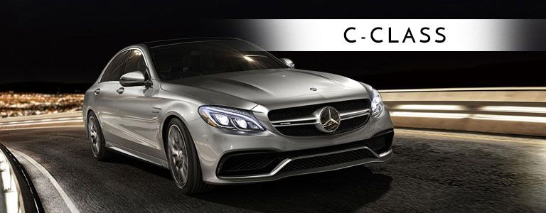 grey 2018 Mercedes-Benz C-Class with banner