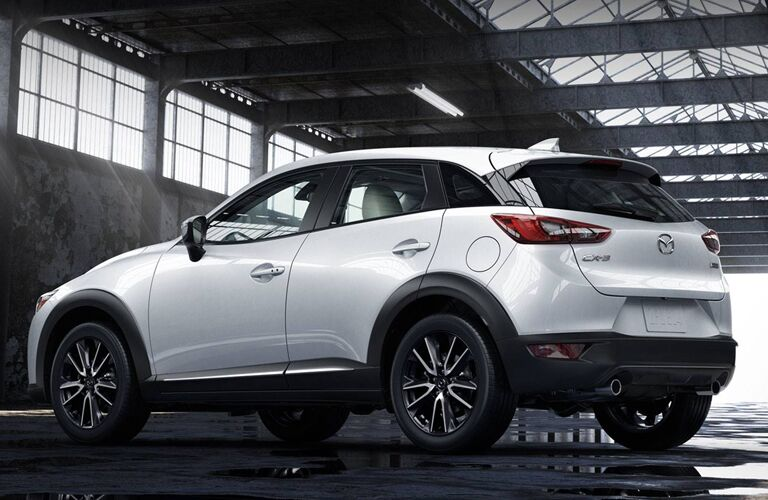 left side view of white mazda cx-3