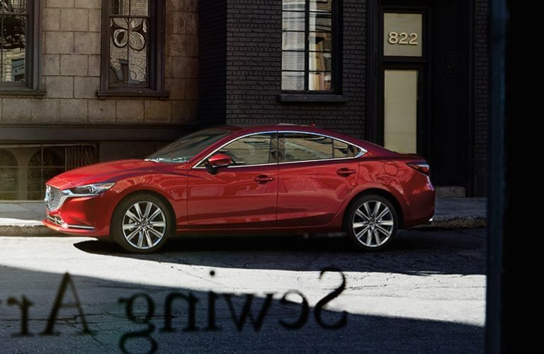 Exterior view of a red 2019 Mazda6 parked on a city street